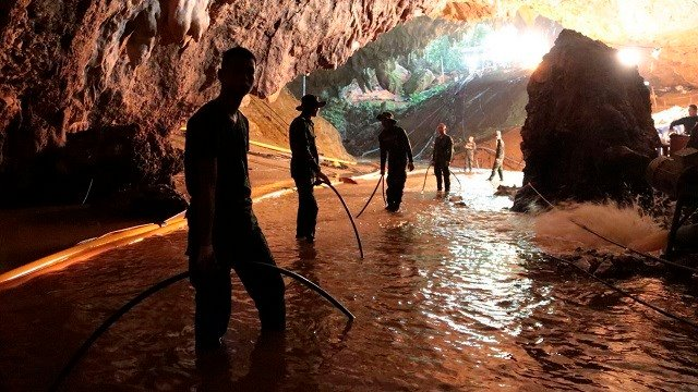 Thai rescue teams arrange water pumping system at the entrance to a flooded cave complex where 12 boys and their soccer coach have been trapped since June 23, in Mae Sai, Chiang Rai province, northern Thailand. (Royal Thai Navy via AP)