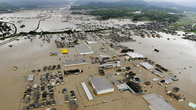 Flooding has killed at least 85 people and forced 2 million others to flee their homes Saturday as heavy rain pounded large areas in southwestern Japan. (Shingo Nishizume/Kyodo News via AP)
