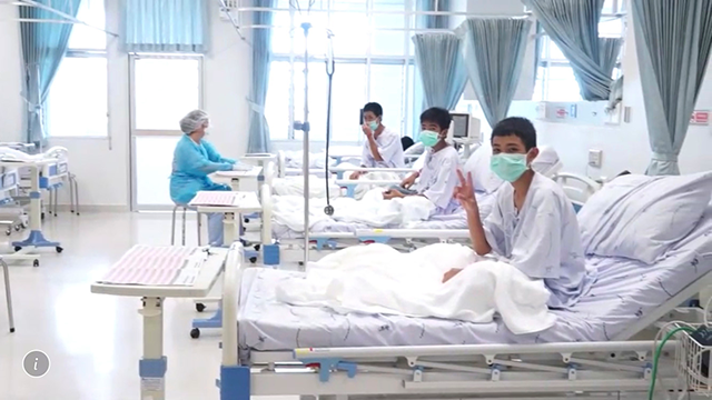 In this image made from video, released by the Thailand Government Spokesman Bureau, three of the 12 boys are seen recovering in their hospital beds after being rescued along with their coach from a flooded cave.