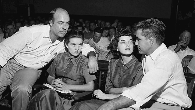 In this Sept. 23, 1955, file photo, J.W. Milam, left, his wife, second left, Roy Bryant, far right, and his wife, Carolyn Bryant, sit together in a courtroom in Sumner, Miss. (AP Photo, File)