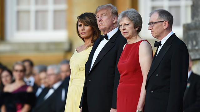 British Prime Minister Theresa May accompanied by her husband Philip, right, stand with U.S. President Donald Trump, and first lady Melania Trump, before a black tie dinner at Blenheim Palace, in Blenheim, England, Thursday, July 12, 2018. (Geoff Pugh/AP)