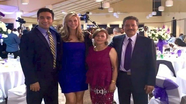Mostafa Toloi (left) and Elizabeth Tammen (second from left) pose with Toloi's parents. The parents will not be able to attend Toloi and Tammen's wedding due to President Trump's travel ban. (WCCO/Family photos via CNN Wire)
