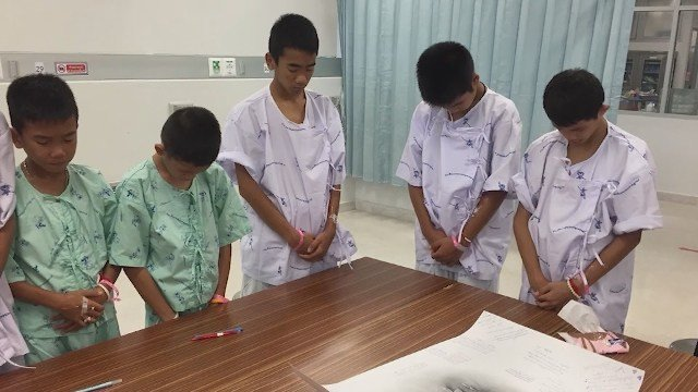 Thai boys trapped in a cave mourn Navy SEAL who died during rescue