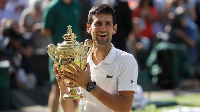 Serbia's Novak Djokovic holds the trophy after winning the men's singles final match against Kevin Anderson of South Africa, at the Wimbledon Tennis Championships, in London, Sunday July 15, 2018.(AP Photo/Kirsty Wigglesworth)