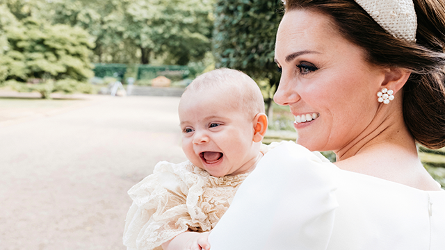 In this Monday, July 9, 2018 photo provided by Kensington Palace, Kate, the Duchess of Cambridge poses for a photo with Prince Louis in the garden of Clarence House, following Prince Louis's baptism at the Chapel Royal, St. James's Palace, in London.