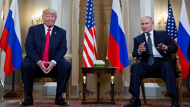 Russian President Vladimir Putin, right, makes a statement as U.S. President Donald Trump, left, looks on at the beginning of a meeting at the Presidential Palace in Helsinki, Finland, Monday, July 16, 2018. (AP Photo/Pablo Martinez Monsivai)