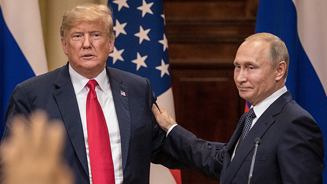 U.S. President Donald Trump (L) and Russian President Vladimir Putin shake hands during a joint press conference after their summit on July 16, 2018 in Helsinki, Finland. (Photo by Chris McGrath/Getty Images)