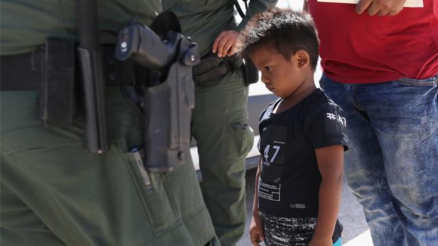 A Honduran boy and father seeking asylum in the US were taken into custody by US Border Patrol in June. (John Moore/Getty Images via CNN)