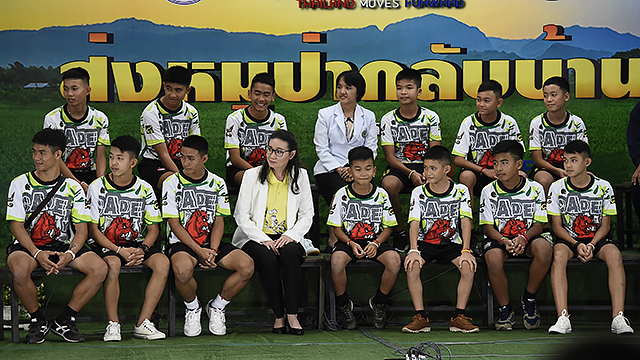 Twelve Thai boys and their football coach, rescued from a flooded cave after being trapped, attend a press conference in Chiang Rai on July 18, 2018, following their discharge from the hospital. (Photo credit should read LILLIAN SUWANRUMPHA/AFP/Getty)