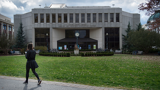 A student walks past the Bender Library on the American University Campus in Washington, D.C., on Wednesday, November 9, 2016. (Photo by Nikki Kahn/The Washington Post via Getty Images)