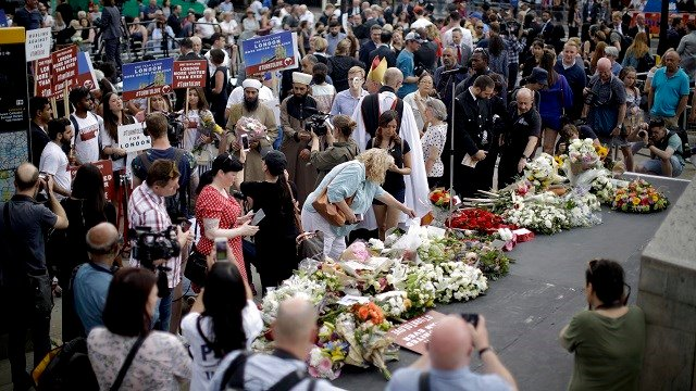 People lay flowers on London Bridge on the anniversary of which eight people were killed and almost 50 injured in June 2017 when terrorists ran down pedestrians on the bridge then stabbed people at bars. (AP Photo/Matt Dunham)
