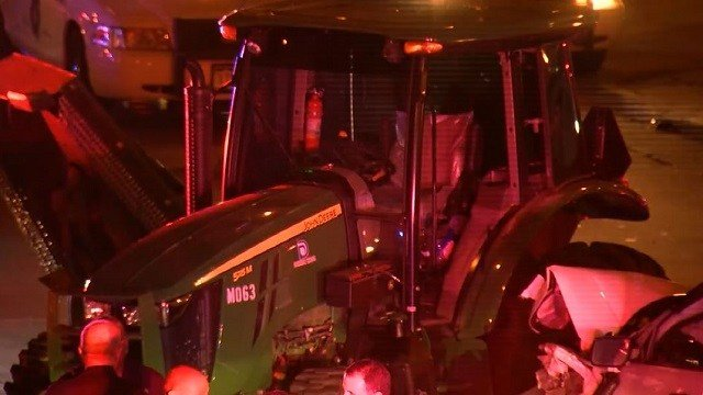 Police work a scene in Denver after a man on this stolen John Deere tractor led police on a chase for 30 minutes. (KMGH via CNN Wire)