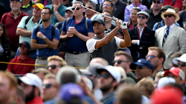 Tiger Woods briefly shared the lead on a pulsating third day of the Open at Carnoustie before ending four shots back in the slipstream of defending champion Jordan Spieth. (Getty Images via CNN)