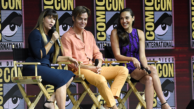 "Patty Jenkins, from left, Chris Pine and Gal Gadot speak at the Warner Bros. Theatrical panel for ""Wonder Woman 1984"" on day three of Comic-Con International on Saturday, July 21, 2018, in San Diego. (Photo by Chris Pizzello/Invision/AP)"