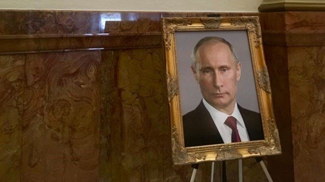 At the Colorado Capitol, someone placed a portrait of Russian President Vladimir Putin where that of President Donald Trump is supposed to be. (Steve Fenberg/Twitter)