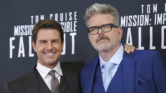 "Actor Henry Cavill, left, and director, writer, producer Christopher McQuarrie attend the U.S. premiere of ""Mission: Impossible - Fallout"" at The Smithsonian National Air and Space Museum on Sunday, July 22, 2018 in Washington. (Brent N. Clarke/AP)"