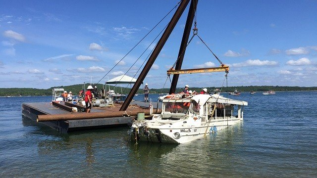 The duck boat that capsized during a storm in southwestern Missouri, which left 17 people dead, was raised to the surface of Table Rock Lake on Monday in an effort overseen by the Coast Guard. (Brad Parks/CNN)