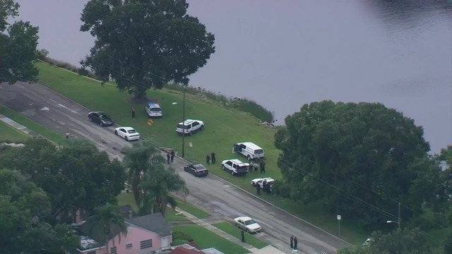 Child pulled from Tampa river dies, woman in custody