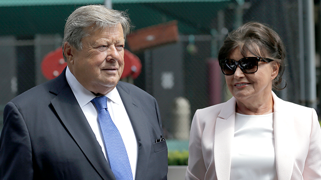 Viktor and Amalija Knavs listen as their attorney makes a statement in New York, Thursday, Aug. 9, 2018. First Lady Melania Trump's parents have been sworn in as U.S. citizens. (AP Photo/Seth Wenig)
