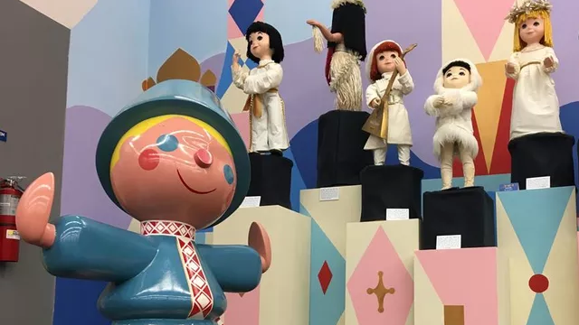 A clock figure and six animated dolls from Disneyland's It's A Small World attraction are among the rare items set for auction. (CNN)