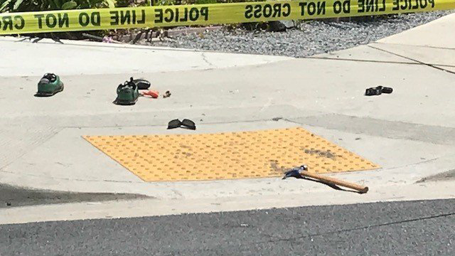 A hammer, shoes and other personal items left over at the scene of a bizarre rampage in downtown El Cajon. (KSWB via CNN)