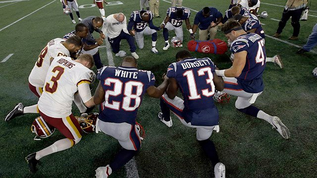 Washington Redskins and New England Patriots kneel at midfield after a preseason NFL football game, Thursday, Aug. 9, 2018, in Foxborough, Mass. (AP Photo/Steven Senne)
