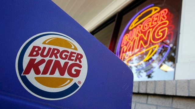 This Aug. 23, 2010 file photo shows company logos on display at a Burger King restaurant in Mountain View, Calif. (AP Photo/Paul Sakuma, File)