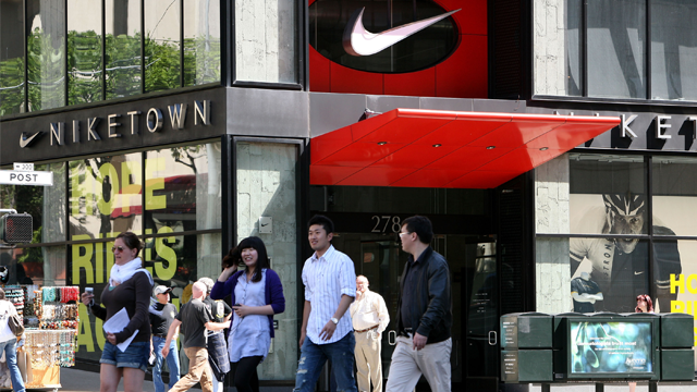 Pedestrians walk by a NikeTown store May 15, 2009 in San Francisco, California. Athletic shoe and sports apparel maker Nike Inc. (Photo by Justin Sullivan/Getty Images)