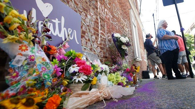Susan Bro, mother of Heather Heyer who was killed during last year's Unite the Right rally, speaks with reporters at the spot where her daughter was killed in Charlottesville, Va., Friday, Aug. 10, 2018. (AP Photo/Steve Helber)