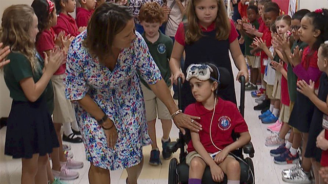 Morgan Allen is fighting a rare form of brain cancer, but being around her fellow students is just what she needed. (WFTS via CNN)