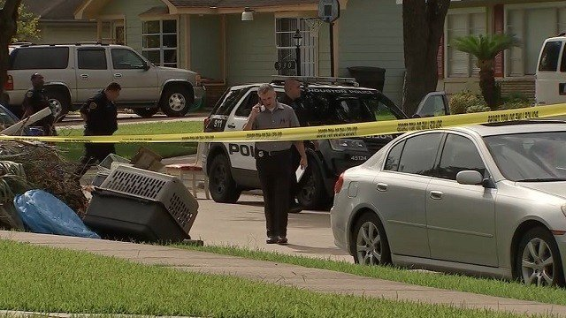 Houston police work the scene where a woman was found stabbed to death Saturday morning. (KTRK via CNN Wire)