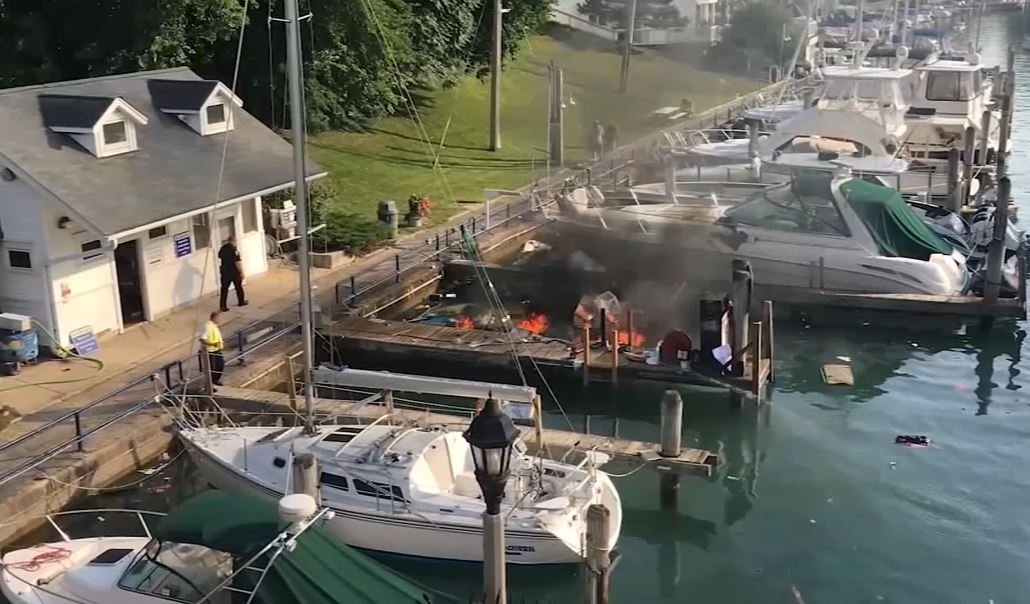 Officials work the scene of a boat explosion north of Chicago. One man was killed and another was injured. (WLS-TV via CNN Wire)
