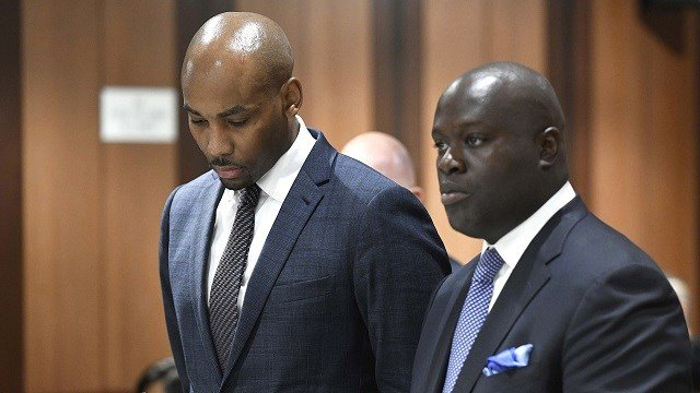 In this Thursday, Aug. 9, 2018, photo, Jamill Jones, left, appears in Queens Criminal Court in New York. The parents of a Florida man who died after he was punched by Jones, an assistant basketball coach at Wake Forest University. (AP, Pool)
