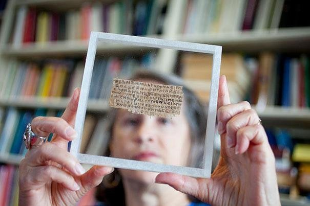 Harvard Professor Karen King with papyrus fragment that suggests Jesus may have been married.