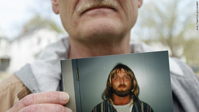 Clay Rogers holds a photo of his brother Glen Rogers, who is awaiting execution in Florida.  (CNN)