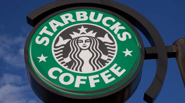 "Starbucks plans to buy ads in the Washington Post and New York Times later in the week as part of its ""Come Together"" campaign."