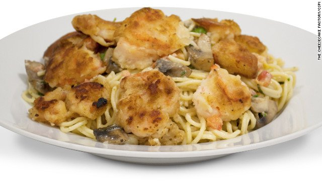Bistro shrimp pasta from The Cheesecake Factory. This dish of crispy battered shrimp, fresh mushrooms and arugula is tossed with spaghettini in a basil-garlic-lemon cream sauce. It weighs in at 3,120 calories.