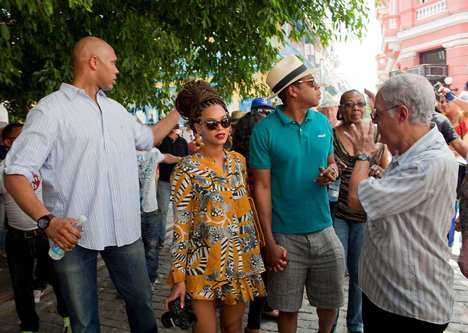 U.S. singer Beyonce and her husband, rapper Jay-Z, right, tour Old Havana as a body guard, left, and tour guide, right, accompany them in Cuba, Thursday, April 4, 2013.
