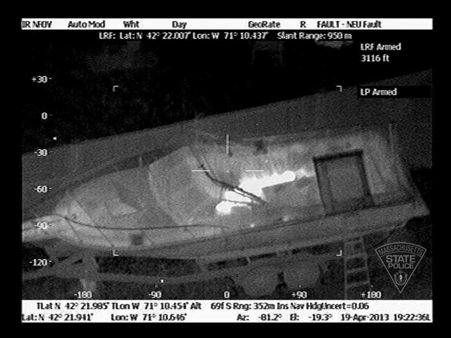 Aerials photos of bombing suspect hiding in homeowner's boat. (Massachusetts State Police)