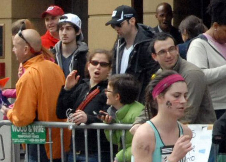 This photo provided by Bob Leonard shows second from left, Tamerlan Tsarnaev, and third from left, Dzhokhar A. Tsarnaev, in the crowd at the Boston Marathon. This image was taken approximately 10-20 minutes before the blast. (AP Photo/Bob Leonard)