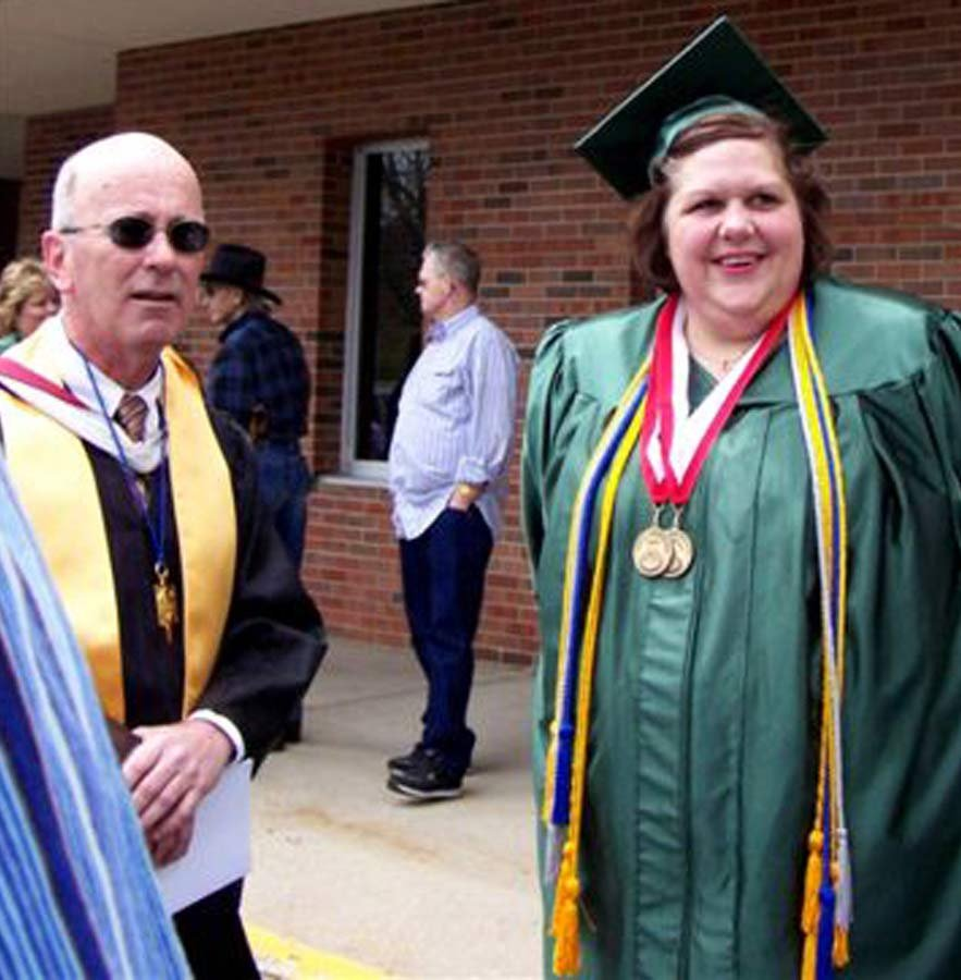 When she graduated college as an nontraditional student, Borawski could barely walk across the stage to accept her diploma. Her professor and friend Chuck Bowden, seen here, says he worried about how limited her life would be at this weight.