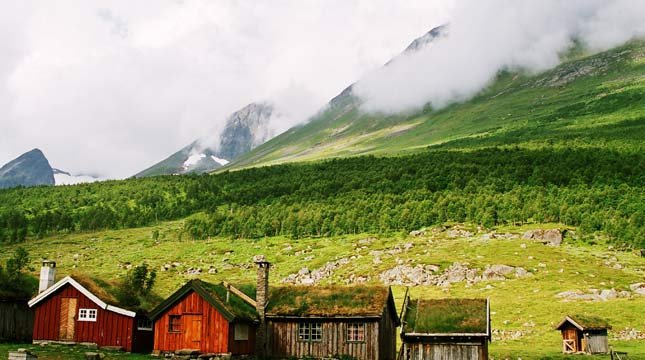 Herdalssetra in Norddal, Norway. These are a few of the little cabins you can rent which are surrounded by majestic mountains.