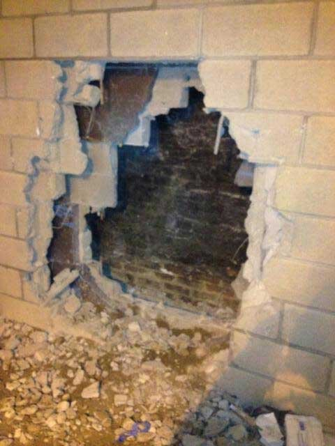 This one shows where firefighters knocked down the wall to remove the student.