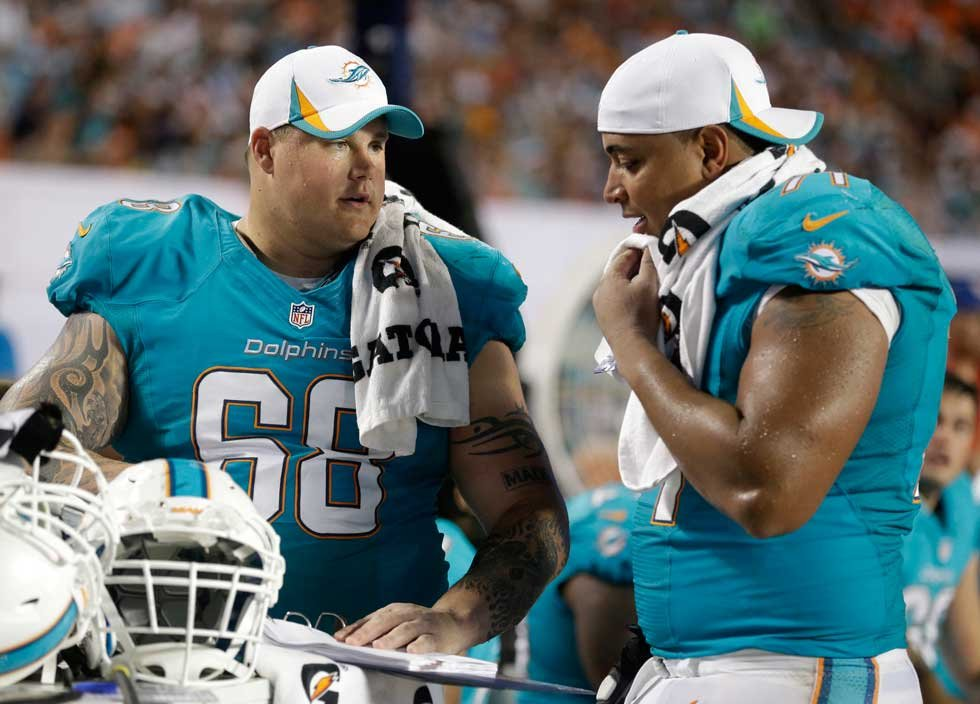 Miami Dolphins' players Richie Incognito (L) and Jonathan Martin (R)