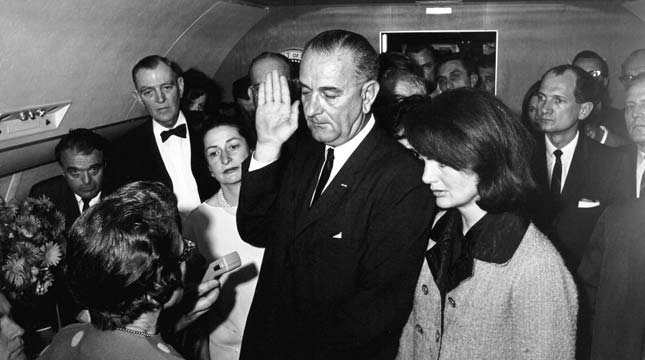 President Lyndon B. Johnson takes the oath of office on Air Force One at Love Field in Dallas, Texas following the assassination of President John F. Kennedy.
