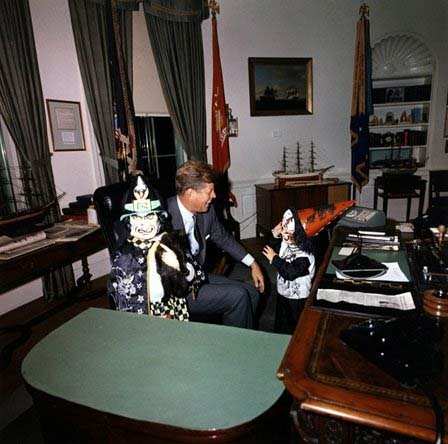 Halloween visitors with the President. President Kennedy, John F. Kennedy Jr., Caroline Kennedy. White House, Oval Office, October 31, 1963.