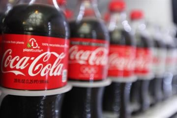 Coca-Cola's sales continue to fizzle -- and the company is planning to cut 1,200 jobs to try and get back on track.