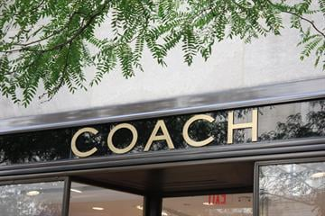 Caption: This image shows the exterior of an unidentified Coach store.