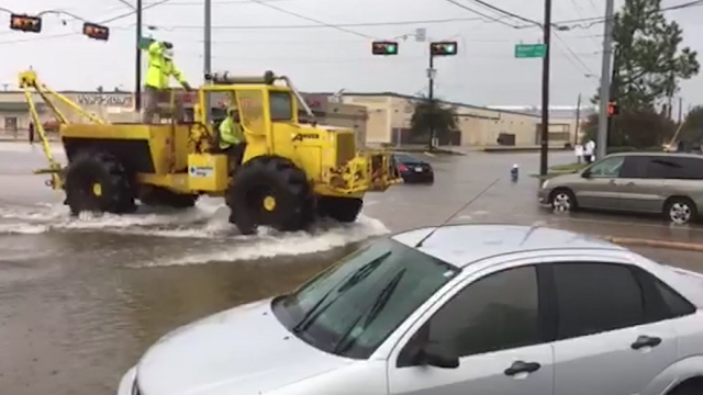 The latest flooded roads isolate southeast texas for Downtown motors beaumont texas