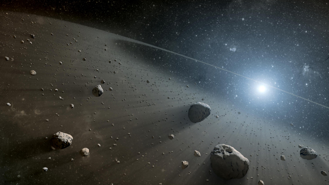 This artist's concept illustrates an asteroid belt around a bright star. (NASA/JLP-Caltech)